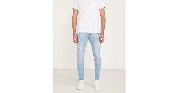 Jeans effetto slavato con  abrasioni